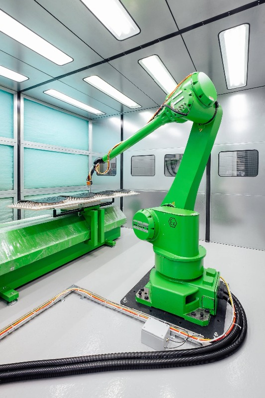In position at Senator the GR-6100, 6 Axis scanning Robot, this Shuttle systems scans - references and recognizes the parts to be sprayed automatically.