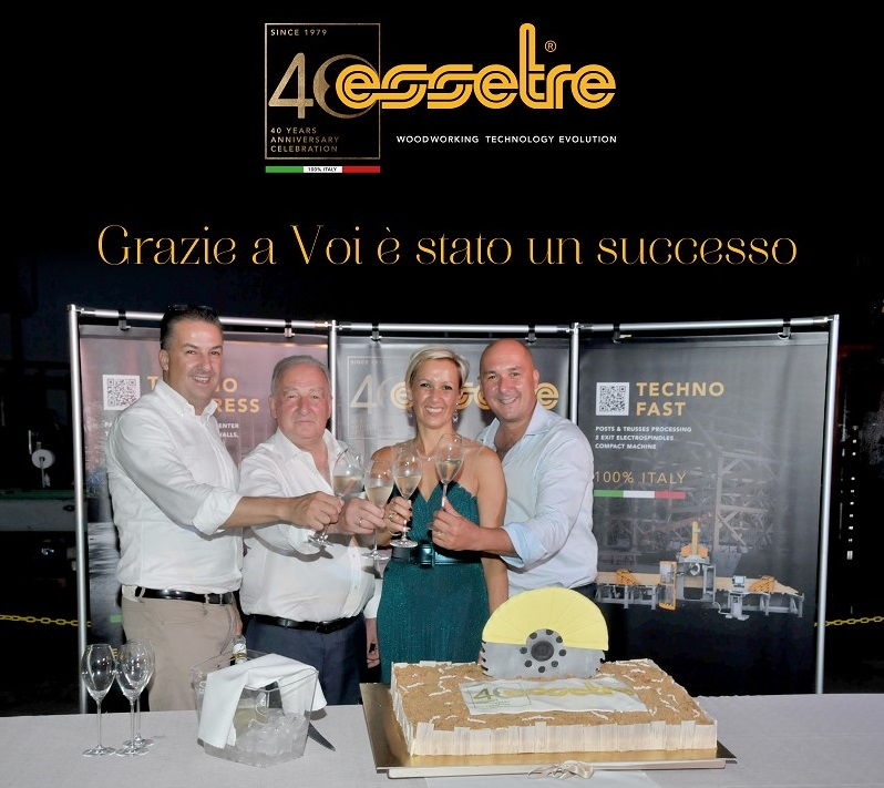 The toast of the Sella Family with those attending the celebration. From left, Nicola, Gianni, Christina and Andrea.